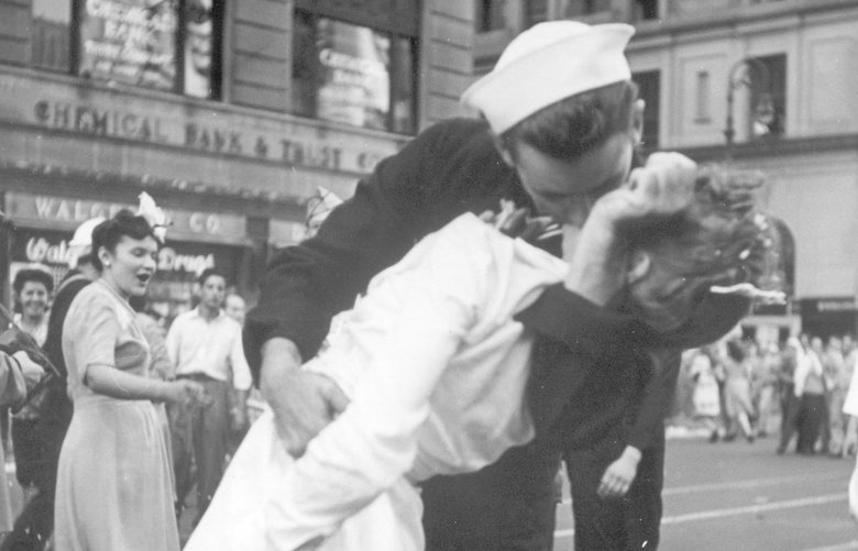 FILE – In this Aug. 14, 1945 file photo provided by the U.S. Navy, a sailor and a woman kiss in New York's Times Square, as people celebrate the end of World War II. The ecstatic sailor shown kissing a woman in Times Square celebrating the end of World War II has died. George Mendonsa was 95. It was years after the photo was taken that Mendonsa and Greta Zimmer Friedman, a dental assistant in a nurse's uniform, were confirmed to be the couple. (Victor Jorgensen/U.S. Navy, File) NYJK114 NYJK114