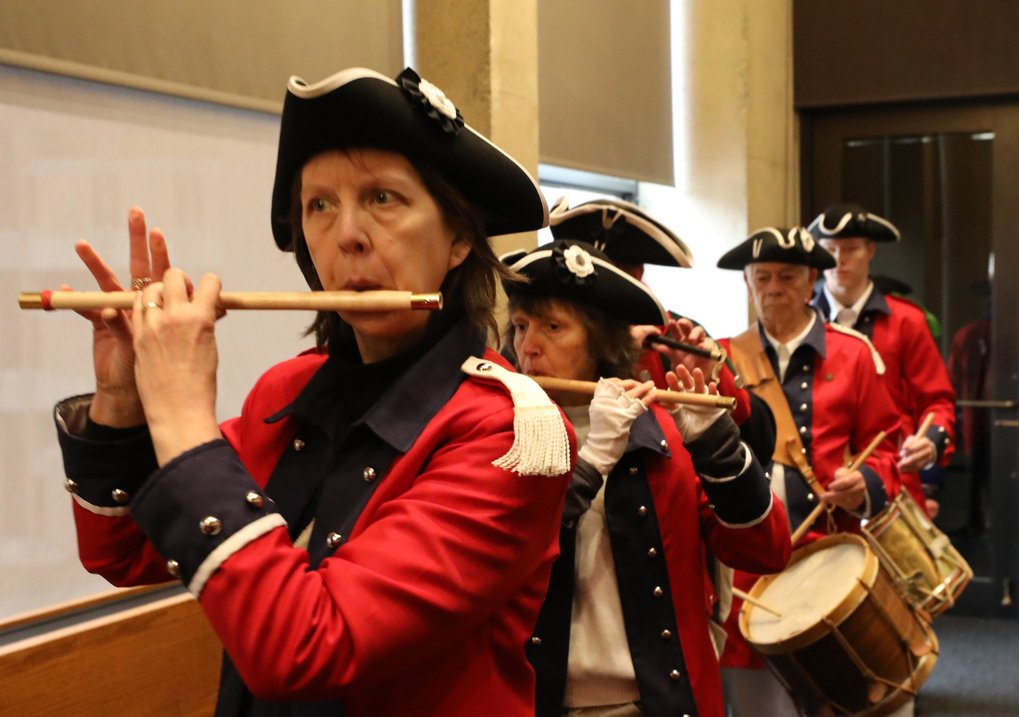 The fife and drum corps of the Washington Society of the Sons of the American Revolution march in Kane Hall before a President's Day program on the University of Washington campus.      Wreath laying and surrounding ceremony on the University of Washington campus by the Greater Seattle Daughters of the American Revolution and Washington Sons of the American Revolution.   (Alan Berner / The Seattle Times)