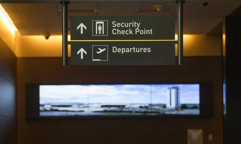 The ramp toward the security check point features a time-lapse video of construction of the new airport terminal. (Mike Siegel / The Seattle Times)