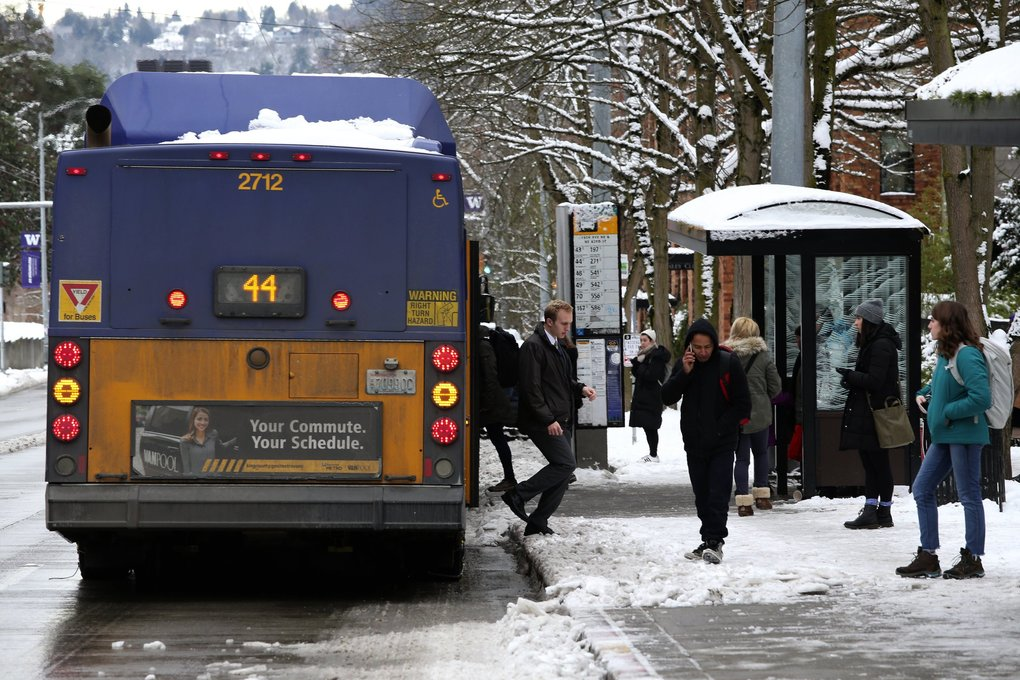 A passenger (not pictured) at a bus stop along 15th Avenue in the University District said she has noticed Metro service to be only slightly late, as temperatures stay below freezing Sunday. (Ken Lambert / The Seattle Times)
