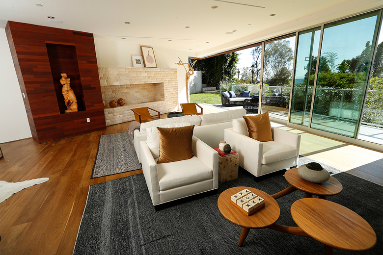 A great room with indoor-outdoor living spaces has views of the city lights. The couple moved into the 6,471-square-foot home as a change of pace from the enormous Playboy Mansion. (Mel Melcon / Los Angeles Times)