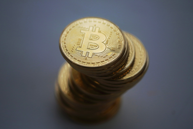 A collection of Bitcoins, a form of cryptocurrency. (Bloomberg photo by Chris Ratcliffe).