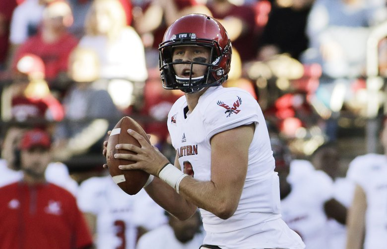 Eastern Washington quarterback Gage Gubrud, left, looks to pass the ball during the first half of an NCAA college football game against Washington State in Pullman, Wash., Saturday, Sept. 3, 2016. (AP Photo/Young Kwak)