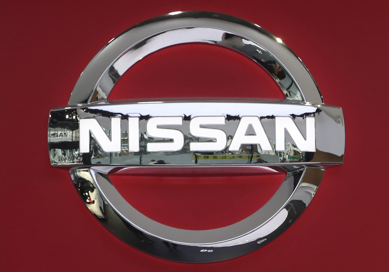 In this Feb. 5, 2019, photo, the logo of Nissan Motor Co., is seen at its showroom in Tokyo. Nissan reported on Tuesday, Feb. 12, 20109, a drop in third quarter profit to about a fourth of the previous year's because of the absence of perks from U.S. tax reforms that lifted profits a year ago. (AP Photo/Koji Sasahara)