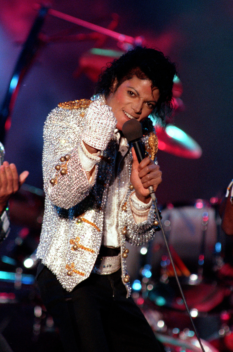 """FILE – In this Dec. 3, 1984 photo, Michael Jackson performs with his brothers at Dodger Stadium in Los Angeles, as part of their Victory Tour concert. Michael Jackson accusers Wade Robson and James Safechuck say that the Sundance Film Festival is first time they've ever felt public support for their allegations the King of Pop molested them. The documentary """"Leaving Neverland,"""" which premiered at the festival in Jan. 2019, and will air on HBO in two parts on March 3 and 4, chronicles how their lives intersected with Jackson's. (AP Photo/Doug Pizac, File)"""