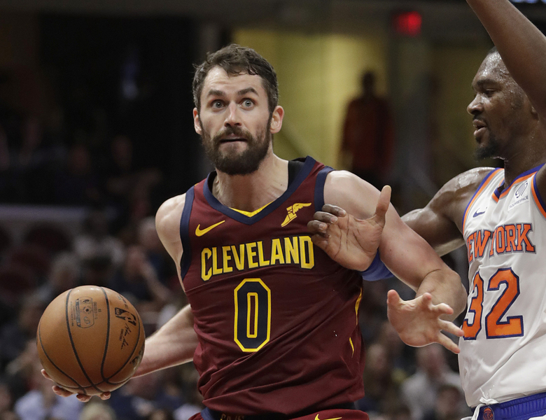 FILE – In this Feb. 11, 2019, file photo, Cleveland Cavaliers' Kevin Love (0) drives past New York Knicks' Noah Vonleh (32) in the first half of an NBA basketball game, in Cleveland. Love relaxed on the beach under the warm Caribbean sun during the All-Star break. He's hoping it keeps shining on him and the Cavaliers in the second half of a depressing, gloomy season.(AP Photo/Tony Dejak, File)