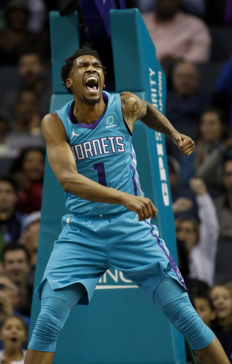 Charlotte Hornets guard Malik Monk reacts after dunking against the Memphis Grizzlies in the second half of an NBA basketball game in Charlotte, N.C., Friday, Feb. 1, 2019. (AP Photo/Nell Redmond)