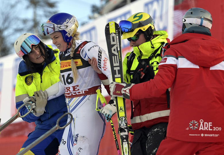 FILE – In this Tuesday, Feb. 5, 2019 file photo United States' Lindsey Vonn is assisted after crashing during the women's super G at the alpine ski World Championships, in Are, Sweden. (Pontus Lundahl/TT via AP, File)