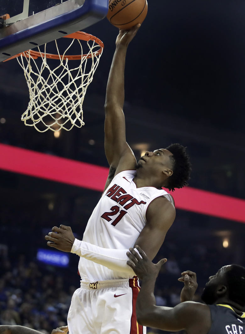 Miami Heat center Hassan Whiteside (21) shoots over Golden State Warriors' Draymond Green during the first half of an NBA basketball game, Sunday, Feb. 10, 2019, in Oakland, Calif. (AP Photo/Ben Margot)