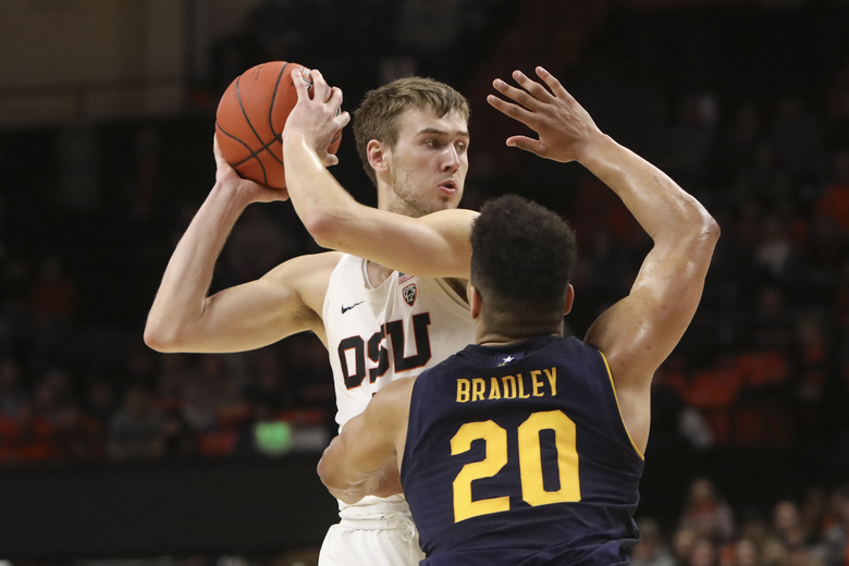 Oregon State's Tres Tinkle (3) looks for a way past California's Matt Bradley (20) during the second half of an NCAA college basketball game in Corvallis, Ore., Saturday, Feb. 9, 2019. Oregon State won, 79-71. (AP Photo/Amanda Loman)