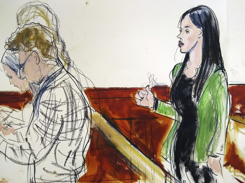 "In this courtroom drawing, Emma Coronel Aispuro, right, wife of Mexican drug kingpin Joaquin ""El Chapo"" Guzman, reacts, Tuesday, Feb. 12, 2019, after a jury in New York, convicted her husband on drug conspiracy charges. (Elizabeth Williams via AP)"