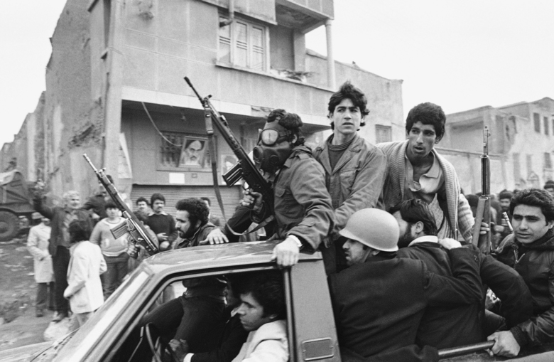 FILE – In this Feb. 12, 1979 file photo, armed rebels, one wearing a gas mask, ride in a truck near the headquarters of Ayatollah Khomeini, in Tehran, Iran. Monday, Feb. 11, 2019 marks the 40th anniversary of the Islamic Revolution. On Feb. 11, 1979, after days of running street battles and uncertainty, Iran's military stood down and allowed the Islamic Revolution to sweep across the country. The caretaker government left behind by the cancer-stricken Shah Mohammad Reza Pahlavi, who weeks earlier left the nation, quickly crumbled as the soldiers once backing it embraced the supporters of Ayatollah Ruhollah Khomeini. (AP Photo/Campion, File)