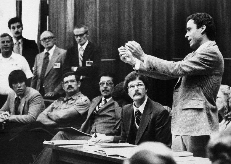 FILE – In this Monday, June 25, 1979 file photo, Ted Bundy presents a motion during his murder trial in Miami. He complained that he could not work on his defense in a 9- by 7-foot cell. Bundy is charged with clubbing two young women to death in a sorority house in Tallahassee. (AP Photo)