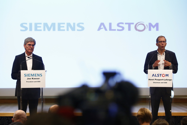 FILE – In this Sept.27, 2017 file photo, Siemens CEO Joe Kaeser, left, and Alstom CEO Henri Poupart-Lafarge attend a joint press conference in Paris. France's finance minister Bruno Le Maire says Wednesday Feb.6, 2019 that EU authorities have decided to reject a merger between France's Alstom and Germany's Siemens railway activities. (AP Photo/Thibault Camus, File)