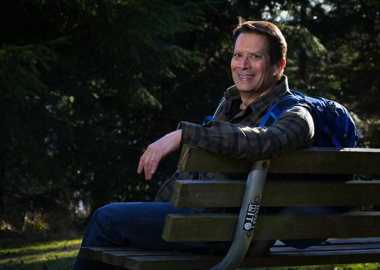 """""""It was just bothering me, the vitriol and the negative pictures … of both people and communities,"""" Paul Pineda said about why he's embarking on this journey with his son. (Ellen M. Banner / The Seattle Times)"""