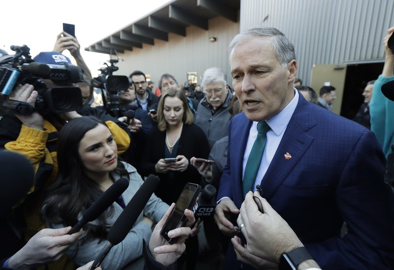 """Asked if he can do both his day job and seek the White House, Washington Gov. Inslee told reporters Friday """"the proof is in the pudding,"""" pointing to his legislative agenda advancing in the Capitol even while he has periodically left the state on political and official business. (Ted S. Warren / The Associated Press)"""