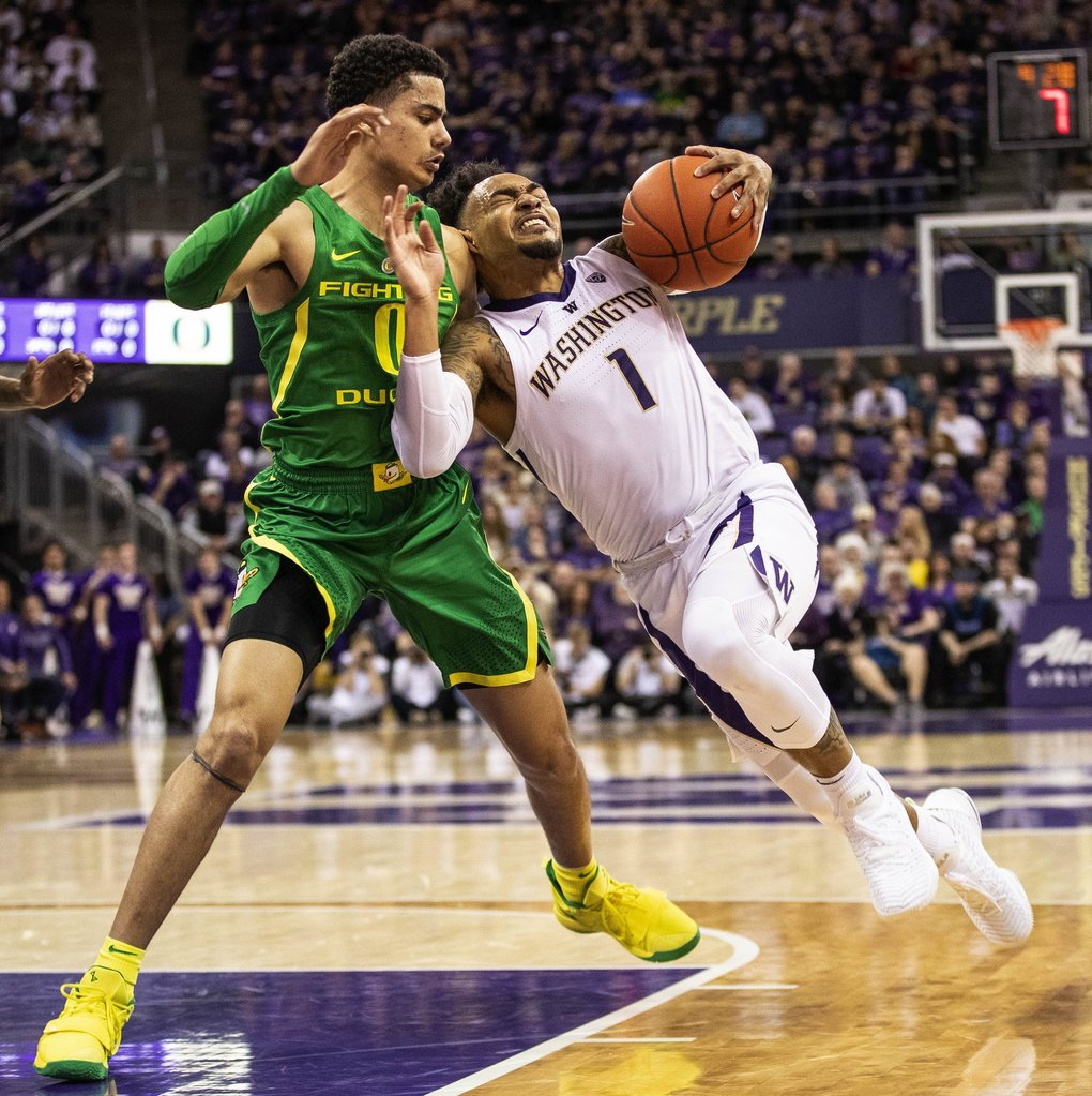 David Crisp tries to push off of Oregon's Will Richardson as he looks for a shot in the lane in the first half.  (Dean Rutz / The Seattle Times)