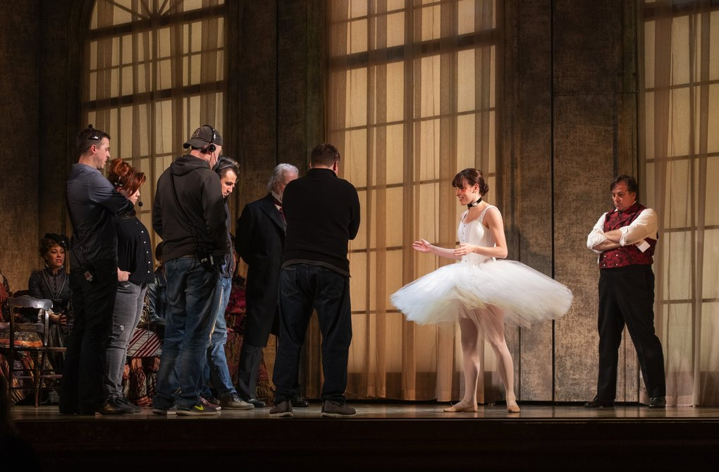 "New York City Ballet principal dancer Tiler Peck, who plays the title role in ""Marie, Dancing Still,"" discusses an issue with cast and crew during a rehearsal at The 5th Avenue Theatre. (Ellen M. Banner / The Seattle Times)"