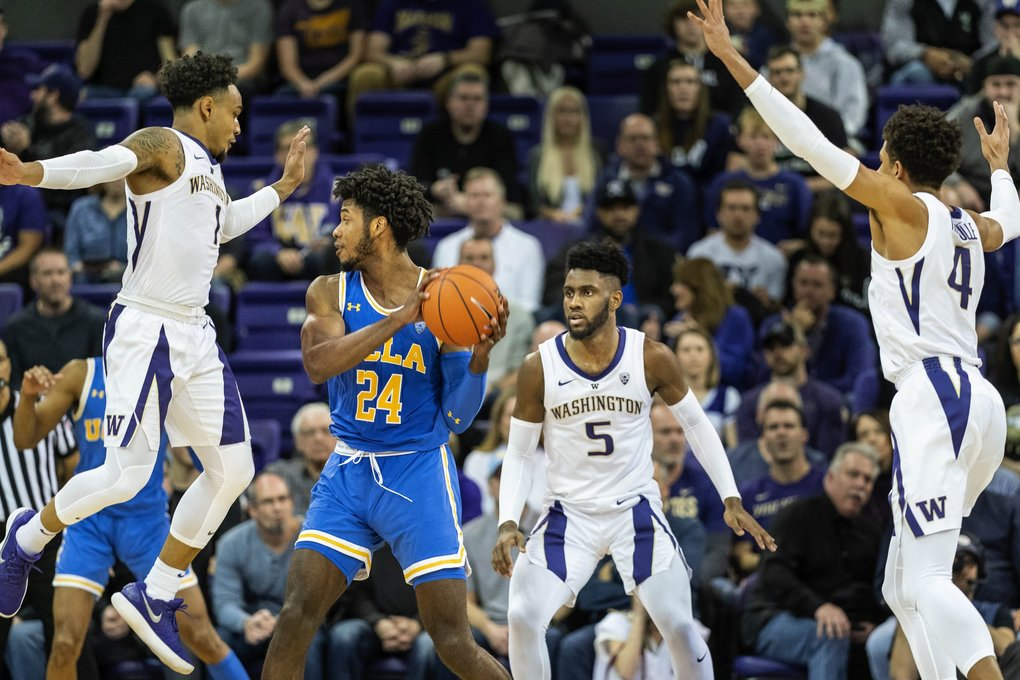 The Huskies defense sets on UCLA's Jalen Hill in the second half.  From left, David Crisp, Jaylen Nowell and Matisse Thybulle.      The UCLA Bruins played the Washington Huskies in NCAA Men's basketball Saturday, February 2, 2019 at Alaska Airlines Arena in Seattle, WA. (Dean Rutz / The Seattle Times)