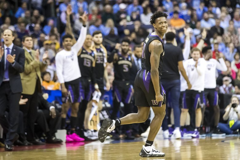 Washington forward Nahziah Carter celebrates a three-pointer in the first half as the Washington Huskies take on the North Carolina Tar Heels for round two of the NCAA Tournament at Nationwide Arena Sunday March 24, 2019 in Columbus, Ohio. (Bettina Hansen / The Seattle Times)