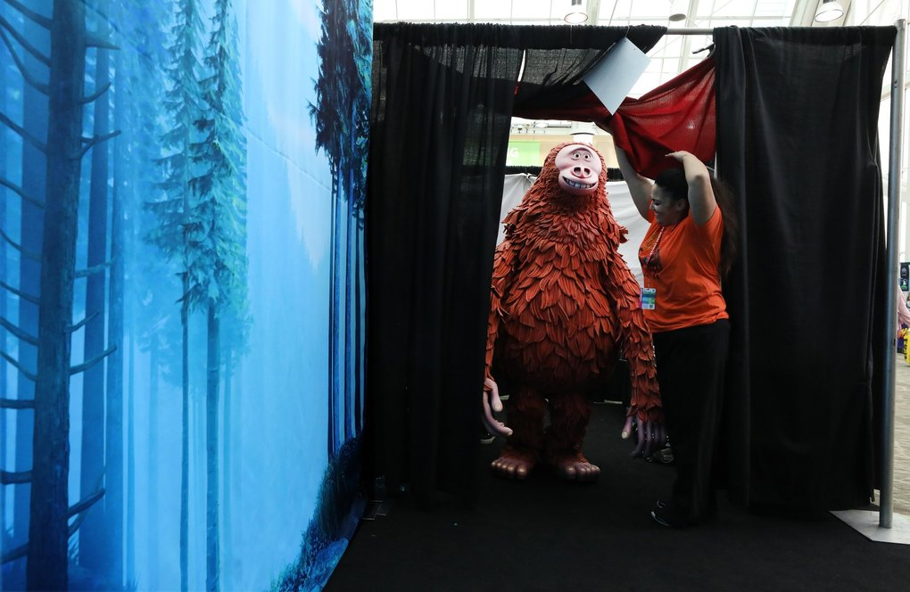 "Link, the main character in the animated film ""Missing Link,"" emerges from the dressing room to be photographed with people attending the Emerald City Comic Con at the Washington State Convention Center in Seattle on Thursday. (Alan Berner / The Seattle Times)"