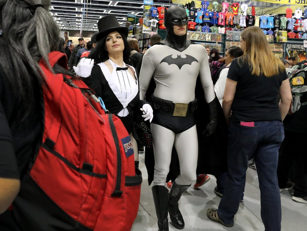 Julie Elledge and her husband, Aaron, dressed as Zatanna and Batman, cruise the vendor booths at Emerald City Comic Con at the Washington State Convention Center on Thursday. They're from Tacoma and made their costumes. (Alan Berner / The Seattle Times)