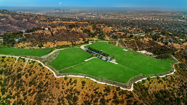 """An undeveloped 157-acre property known as the """"Mountain"""" is now listed for sale at $650 million following a $350-million price cut.  The acreage, which measures about twice the size of Disneyland, was once owned by an Iranian royal and talk show host-turned-TV-producer Merv Griffin."""