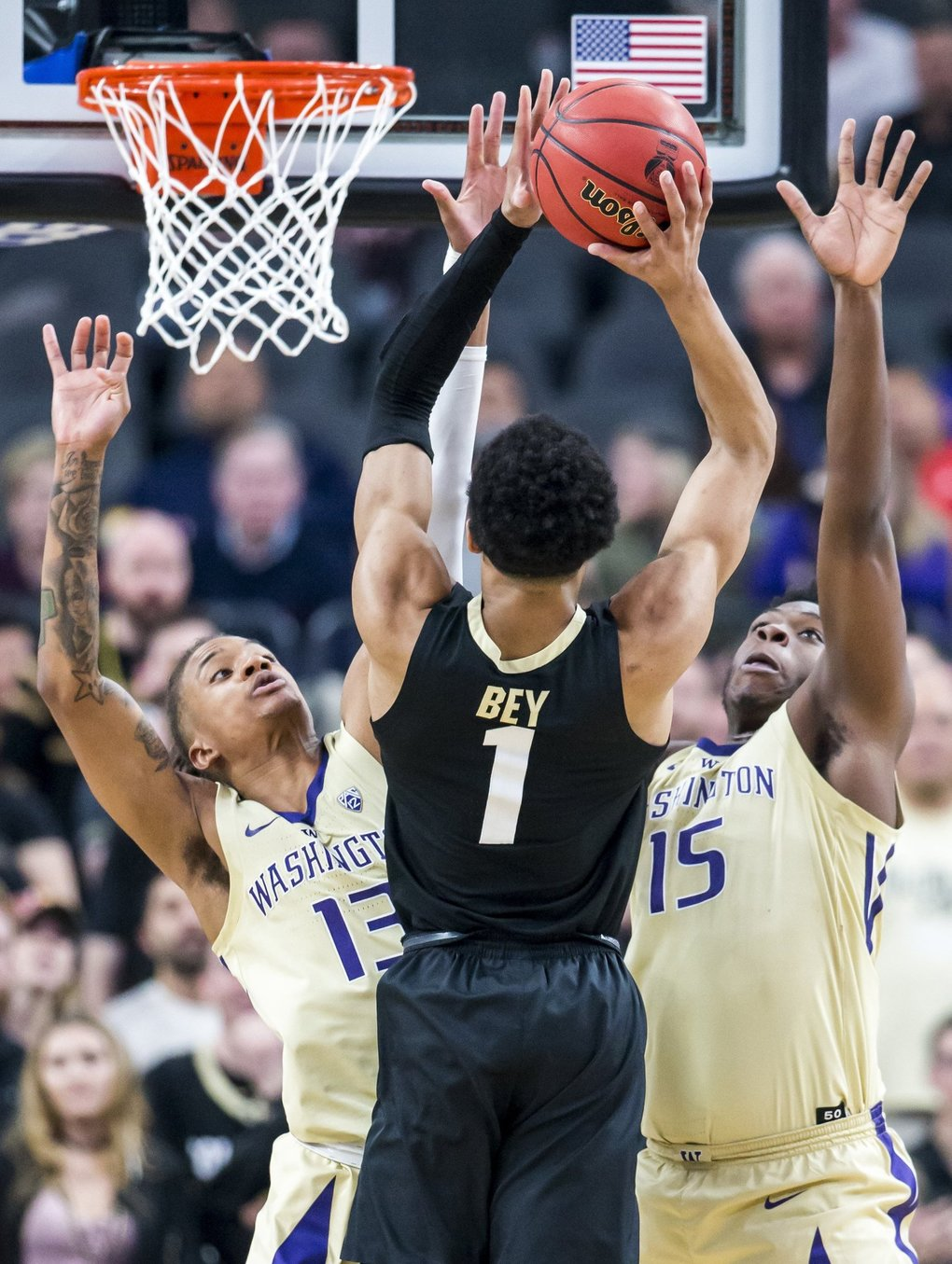 Colorado Buffaloes guard Tyler Bey tries to shoot over Washington Huskies forwards Hameir Wright, left, and Noah Dickerson as the Washington Huskies defeat the Colorado Buffaloes 66-61 for the semifinals of the Pac-12 Tournament at T-Mobile Arena in Las Vegas, Nevada Friday March 15, 2019. (Bettina Hansen / The Seattle Times)