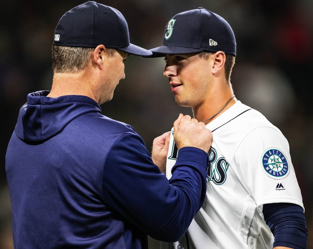 After committing three consecutive errors in the 9th inning that allowed three runs to score, Scott Servais grabs Dylan Moore by the jersey as the Mariners come off the field defeating Boston 6-5.  The Boston Red Sox played the Seattle Mariners in the third game of a four game set Saturday, March 30, 2019 at T-Mobile Park in Seattle, WA. (Dean Rutz / The Seattle Times)