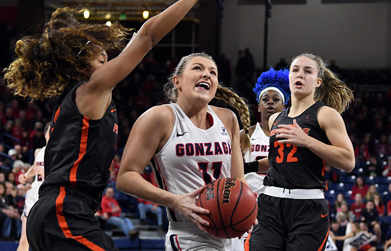 Gonzaga Bulldogs guard Laura Stockton (11) eyes the basket during the first half of a college basketball game, Thurs., Feb. 28, 2019, in the McCarthey Athletic Center. (Colin Mulvany / The Spokesman-Review)