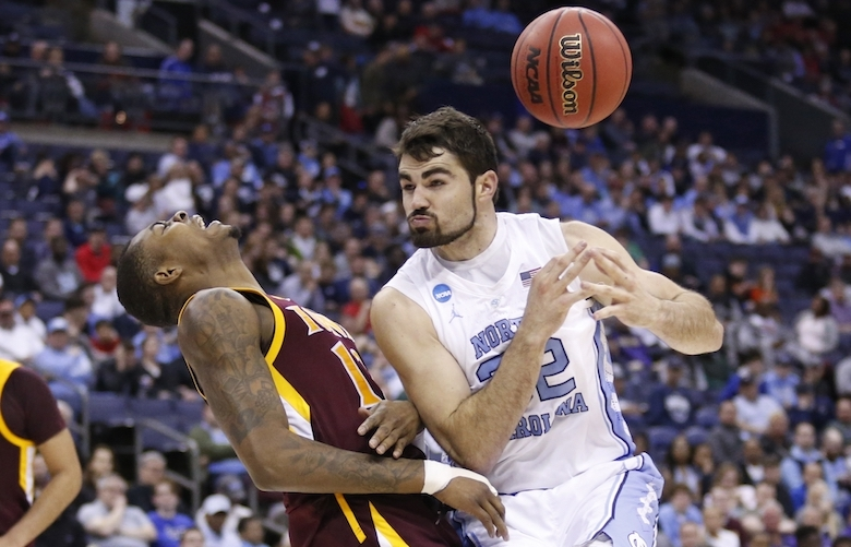 North Carolina's Luke Maye, right, loses control of the ball after colliding with Iona's Tajuan Agee during the second half of a first-round game in the NCAA men'Äôs college basketball tournament in Columbus, Ohio, Friday, March 22, 2019. North Carolina won 88-73. (AP Photo/Paul Vernon) OHTD166 OHTD166