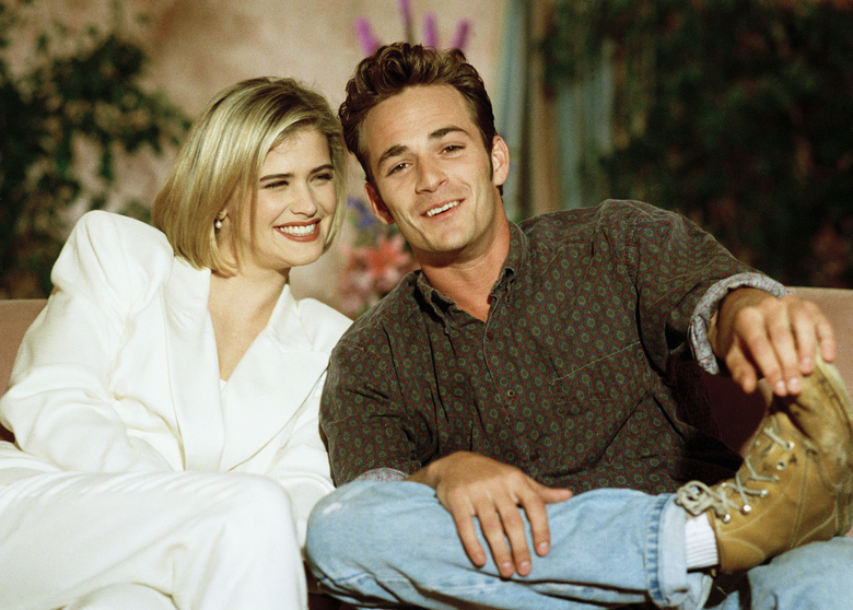 """Kristy Swanson and Luke Perry, co-stars in the new film """"Buffy the Vampire Slayer,"""" talk about handling the hoopla of sudden fame during an interview in Los Angeles, 1992. Perry, who gained instant heartthrob status as wealthy rebel Dylan McKay on """"Beverly Hills, 90210,"""" died Monday, March 4, after suffering a massive stroke. He was 52."""