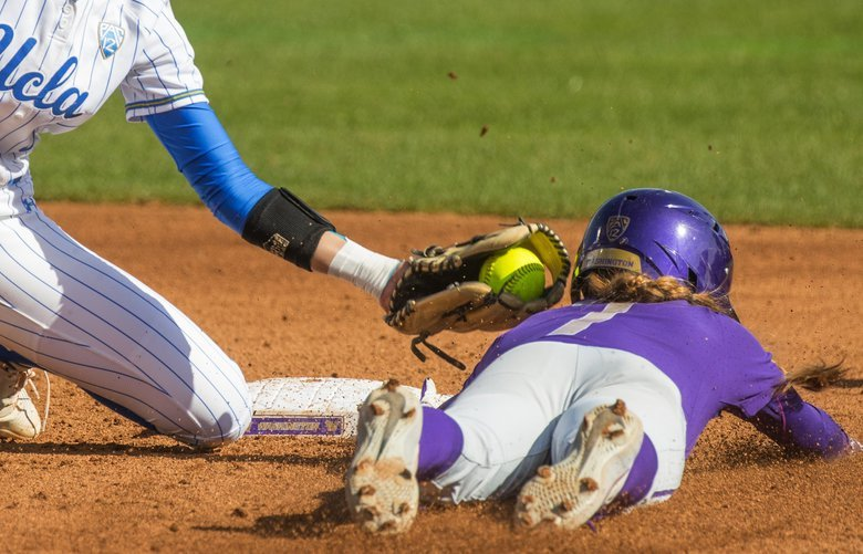 University of Washington's Taryn Atlee is tagged out at 2nd base by UCLA shortstop Briana Perez during 3rd inning action.  Photographed on March 16, 2019. 209610