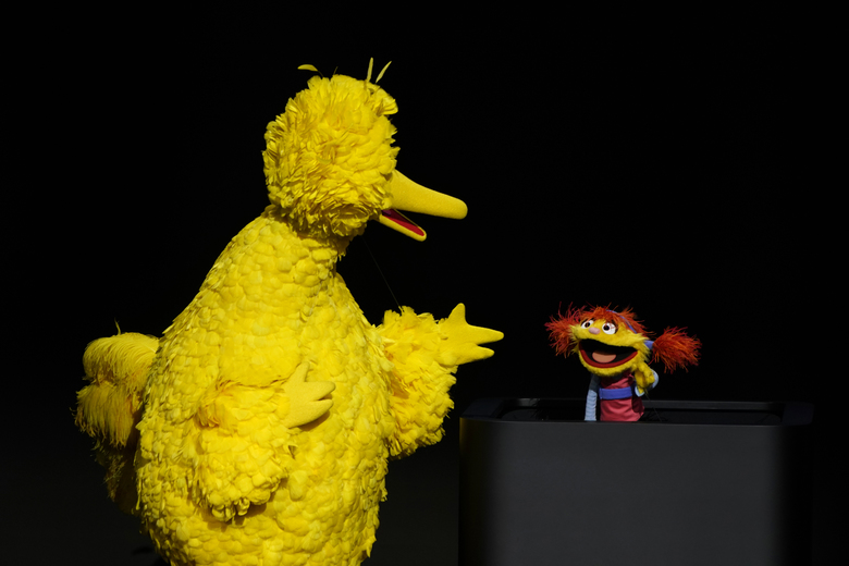 "Characters from ""Sesame Street"" Big Bird, left, and Cody perform at the Steve Jobs Theater during an event to announce new Apple products Monday, March 25, 2019, in Cupertino, Calif. (AP Photo/Tony Avelar)"
