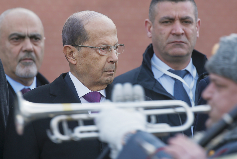 Lebanese President Michel Aoun, second left, attends a wreath laying ceremony at the Tomb of the Unknown Soldier by the Kremlin wall in Moscow, Russia, Tuesday, March 26, 2019. (Maxim Shemetov/Pool Photo via AP)