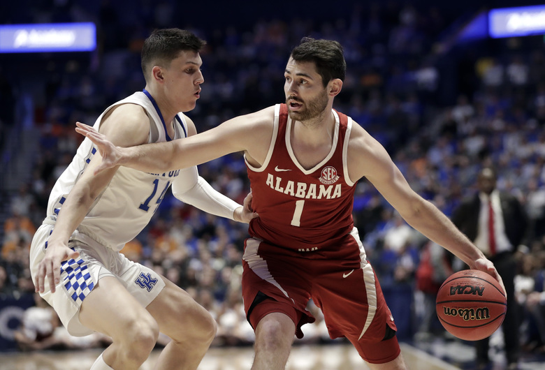 Alabama's Riley Norris (1) tries to get past Kentucky's Tyler Herro (14) in the first half of an NCAA college basketball game at the Southeastern Conference tournament Friday, March 15, 2019, in Nashville, Tenn. (AP Photo/Mark Humphrey)