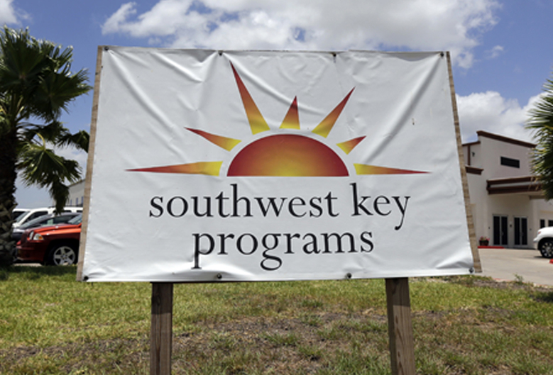 FILE – This June 20, 2014, file photo shows a Southwest Key program sign in Brownsville, Texas. Authorities in Arizona say workers who were seen on video dragging and shoving immigrant children being held at a privately run shelter won't face charges. The Maricopa County Attorney's Office said Friday, March 29, 2019 that there's no reasonable likelihood of proving the workers at a Southwest Key facility committed a crime. (AP Photo/Eric Gay, File)