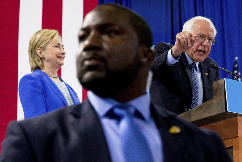 FILE – In this July 12, 2016, file photo, a member of the Secret Service stands guard as Sen. Bernie Sanders, I-Vt., accompanied by Democratic presidential candidate Hillary Clinton, speaks during a rally in Portsmouth, N.H., where Sanders endorsed Clinton for president. (AP Photo/Andrew Harnik, File)