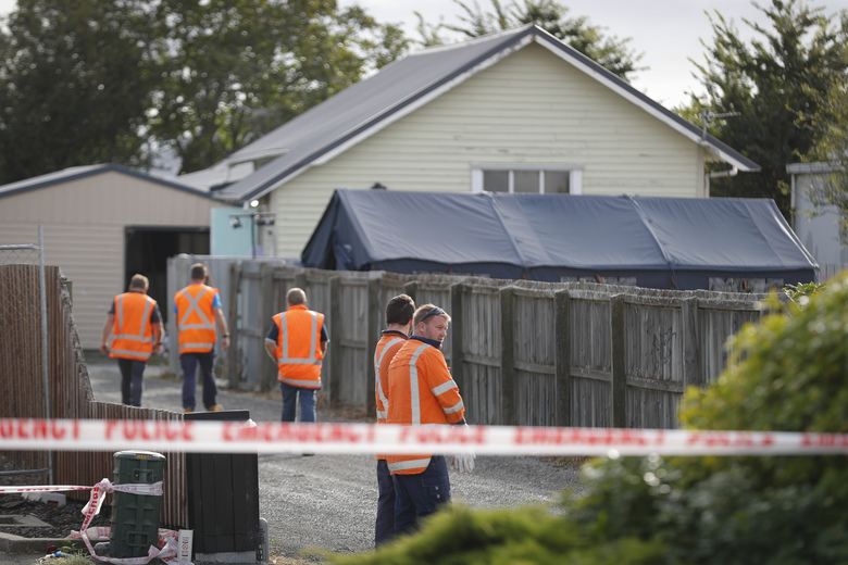 Workers walk outside a crime scene tent at Linwood mosque in Christchurch, New Zealand, on Thursday. (AP photo/Vincent Thian)