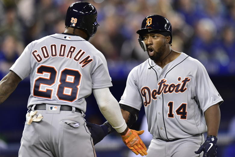 Detroit Tigers' Christin Stewart (14) celebrates his two-run home run with Niko Goodrum (28) during the 10th inning against the Toronto Blue Jays in a baseball game in Toronto, Thursday, March 28, 2019. (Frank Gunn/The Canadian Press via AP)