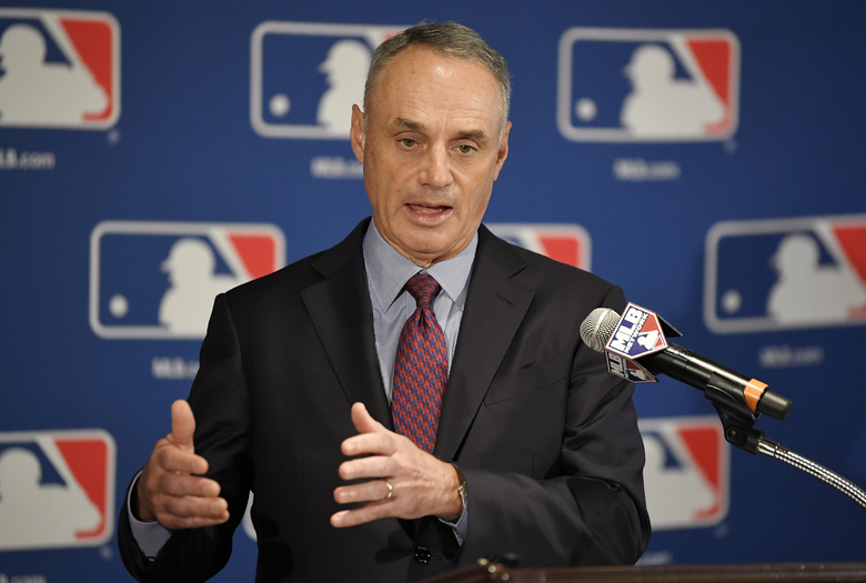 FILE – In this Feb. 1, 2018, file photo, Major League Baseball commissioner Rob Manfred speaks during a news conference in Los Angeles.  Major League Baseball and its players' union reached an unprecedented agreement to discuss renegotiating their labor contract that has three seasons remaining, part of a deal that includes modest rule changes for 2020 and drops pitch clocks until 2022 at the earliest.  (AP Photo/Mark J. Terrill, File)
