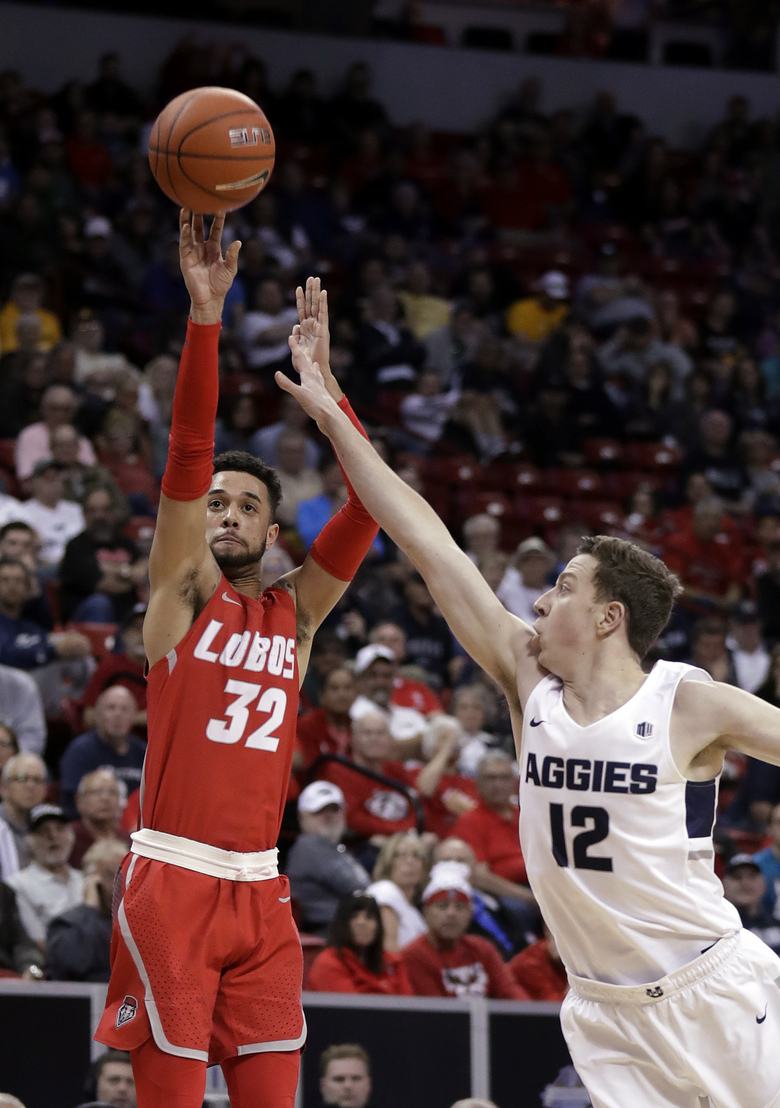 New Mexico's Anthony Mathis (32) shoots as Utah State's Justin Bean (12) defends during the second half of an NCAA college basketball game in the Mountain West Conference men's tournament Thursday, March 14, 2019, in Las Vegas. (AP Photo/Isaac Brekken)