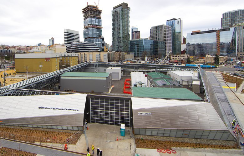 Seattle City Lights new $275 million substation on Minor Avenue and John Street resembles a silver spaceship on the outside and features a dog park on its west side. This view looks south toward downtown Seattle.  Photographed on February 28, 2019.   209167
