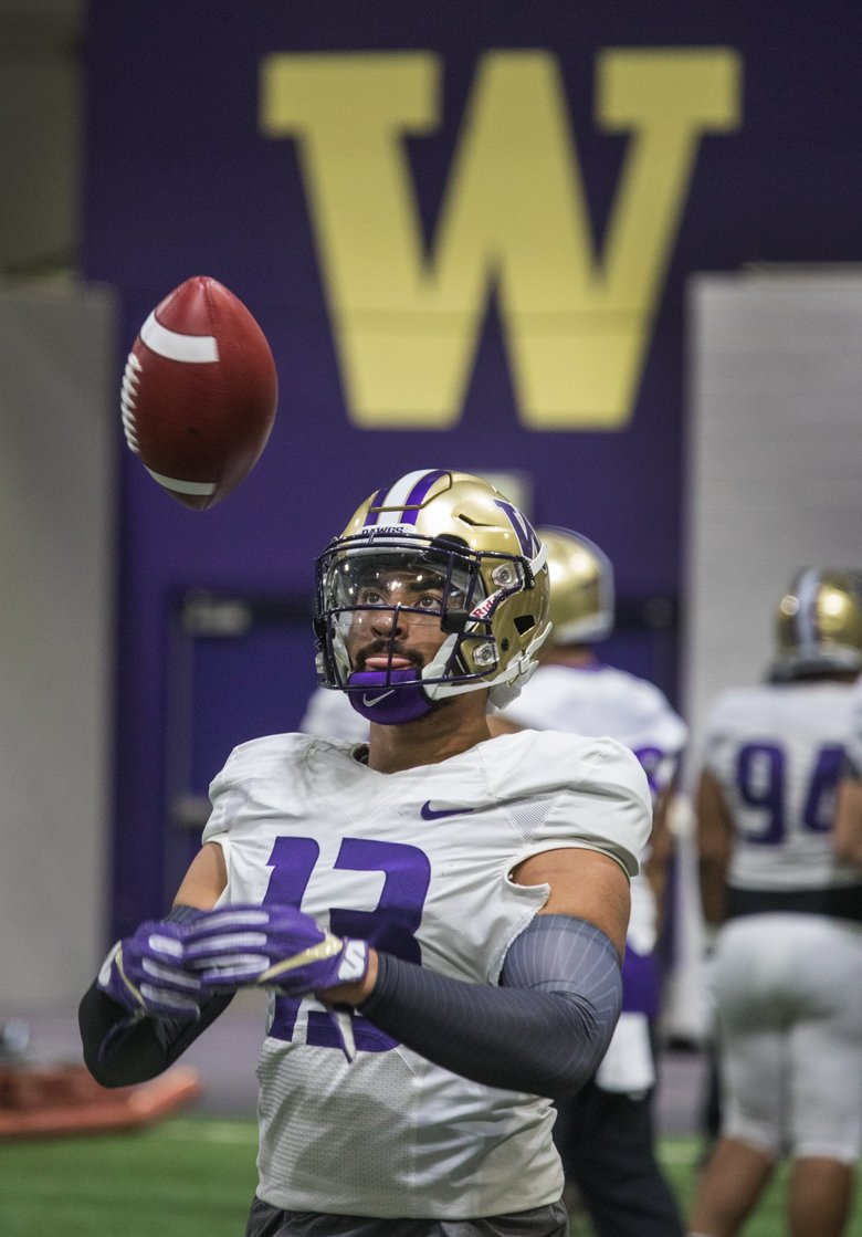 Linebacker Brandon Wellington plays catch before a drill during the fifth UW spring practice held indoors at the University of Washington.   (Steve Ringman / The Seattle Times)