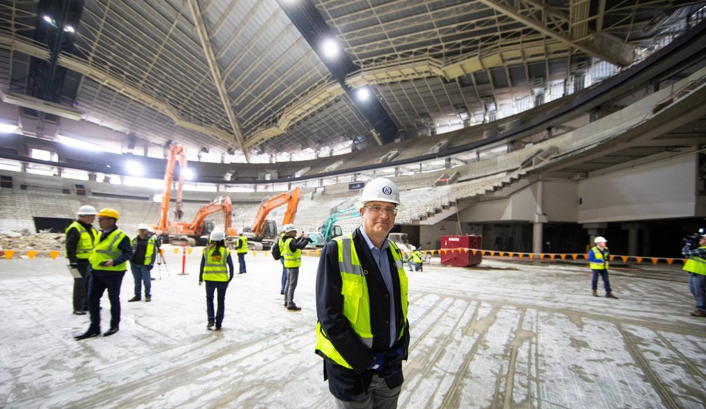 KeyArena's renovation progress shows the interior of the arena, originally built for the 1962 World's Fair, as it is being demolished. Tod Leiweke, CEO, Seattle Hockey Partners lead the tour of the arena that will be completely replaced with the exception of the classic old Coliseum roof. The floor of the new arena will be 15 feet deeper than where the current floor exists today. (Mike Siegel / The Seattle Times)