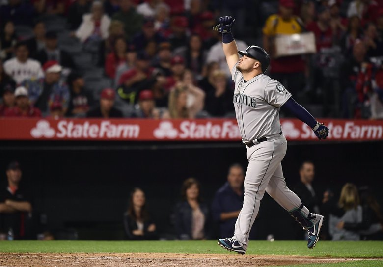 Seattle Mariners' Daniel Vogelbach celebrates after hitting a two-run home run during the fourth inning of the team's baseball game against the Los Angeles Angels on Friday, April 19, 2019, in Anaheim, Calif. (Mark J. Terrill / The Associated Press)