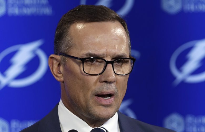 FILE – In this Feb. 26, 2018, file photo, Tampa Bay Lightning general manager Steve Yzerman gestures during a news conference before an NHL hockey game against the Toronto Maple Leafs, in Tampa, Fla.  Two people familiar with the decision say Yzerman will be named general manager of the Detroit Red Wings.  The people spoke Friday, April 19, 2019  morning to The Associated Press on condition of anonymity because the team had not announced the move. The people say Ken Holland will become the team's senior vice president after being its general manager for two-plus decades.   (AP Photo/Chris O'Meara, File) NY109 NY109