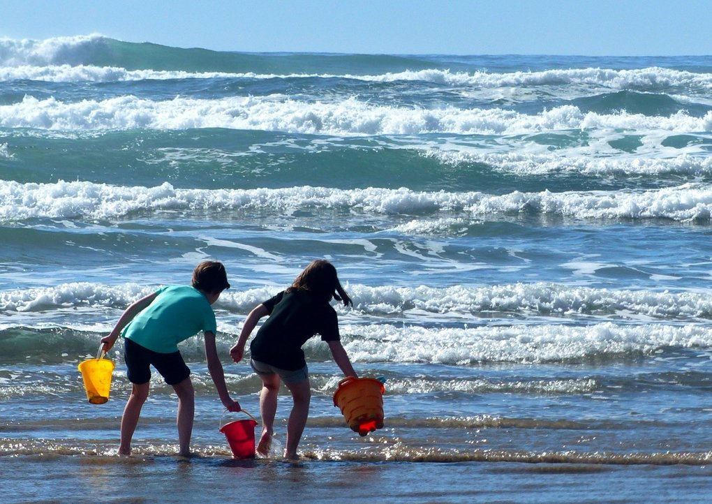 Serious castle builders on Cannon Beach start with plenty of saltwater and wet sand. Experts compete in an annual sandcastle contest in June. (Brian J. Cantwell / Special to The Seattle Times)