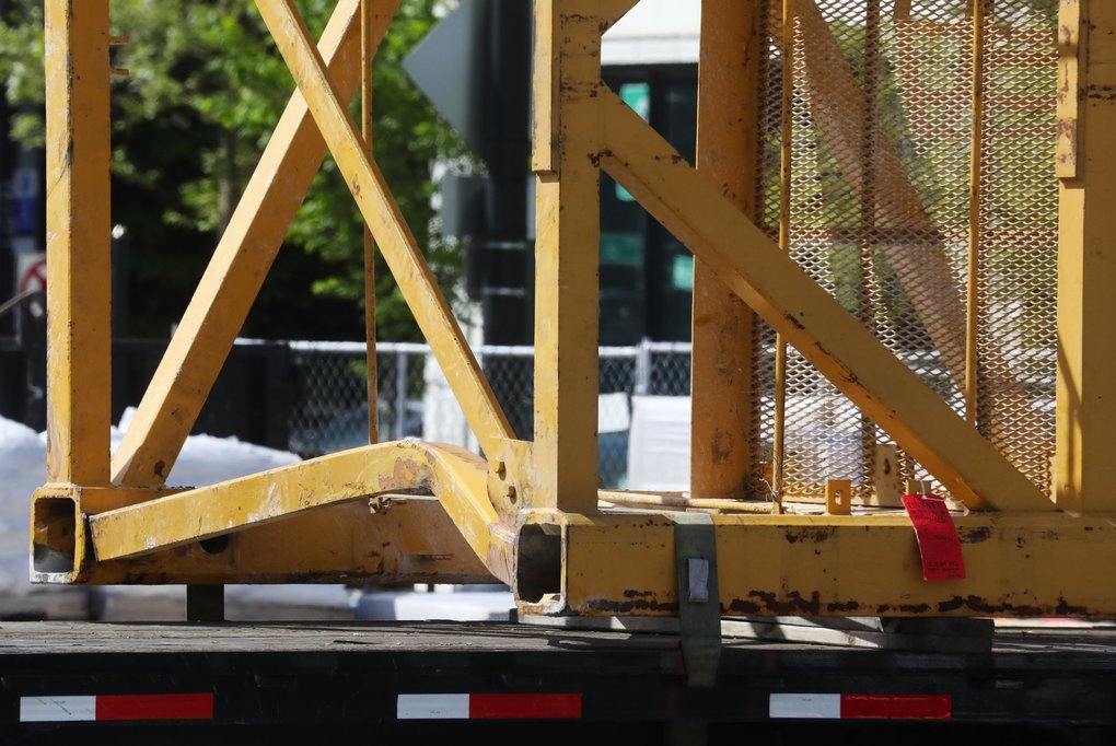 "A bent section of crane at a yard storing damaged pieces from Saturday's fatal crane collapse in Seattle's South Lake Union neighborhood, photographed Sunday, April 28, 2019. At right is a tag that says ""unsafe."" (Ken Lambert / The Seattle Times)"