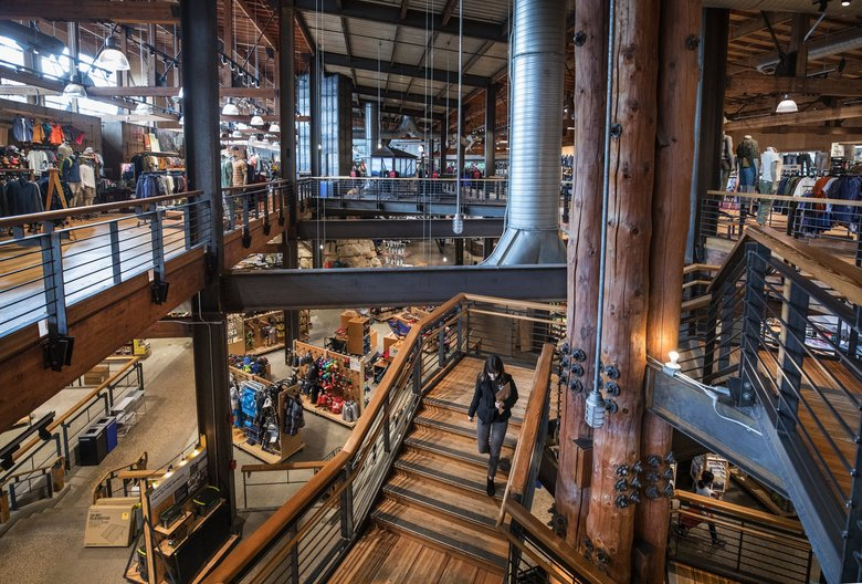 The flagship store of REI , which posted on Tuesday record numbers for 2018 — $2.78 billion in sales, $47.1 million in net income, and $204 million in member dividends and other rewards, (Steve Ringman / The Seattle Times)